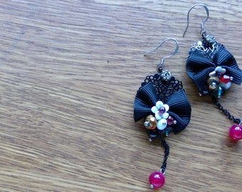 Hand made earrings by Emma Frances Boutique. Beads and bows, one of a kind, each pair are different