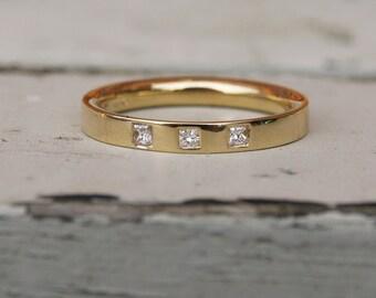 Flush set square diamond gold band, princess cut eternity ring