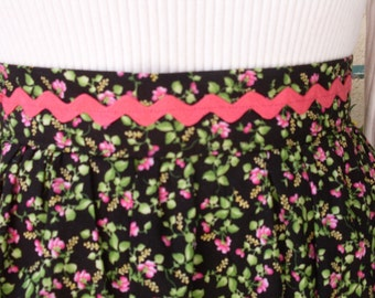 Vintage Inspired Apron Black with Hot Pink and Green Floral Print Trimmed with Hot Pink Rick Rack