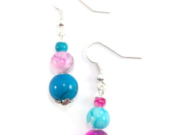 Silver earrings, trio of glass beads, pink and blue shade. google traduction