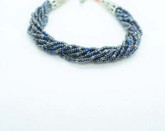 Twisted beaded bracelet, black color, silver