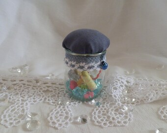 Glass jar is hand