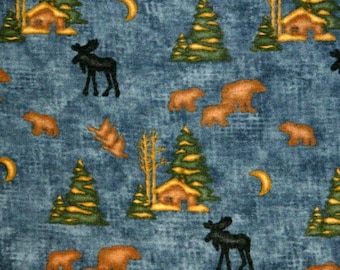 Moda Fabric ~ Winter at the Lodge by Holly Taylor ~ Black Moose, Bears, Cabin (1- 1/2 to 3 Inches) on a BlueBackground~ FLANNEL