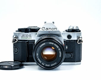 CANON AE-1  Program Film SLR Camera with Canon  Speedlite 188A Flash and Optional 80-200mm lens