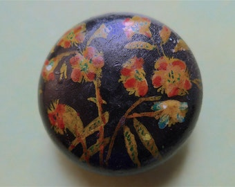 Wooden folk button, antique.  Hand painted and hand made, convex, floral with a black japanned base, lacquered top. c1900.