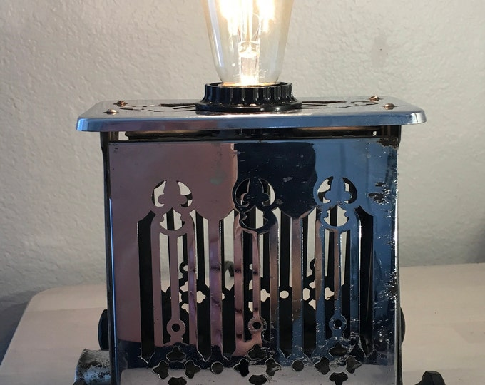 Lamp. Accent lighting. 1920s art decor metal toaster. Cute addition to a decor kitchen.