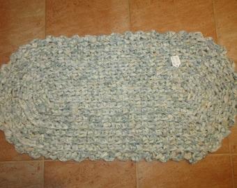 Rag rug, crocheted, light teal, measures 18 by 35.  JW223
