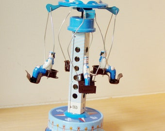 Vintage metal carousel, blue and white carnival ride with sailors, retro collectible toy