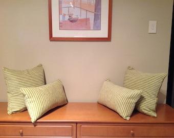 Thin striped green cushion