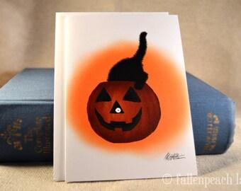 Black Cat in Pumpkin Greeting Card - Sammy Eyes a Pumpkin Illustration