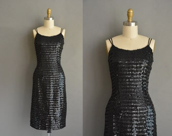 50s saucy black sparkly sequin vintage wiggle dress for holiday party. vintage 1950s dress