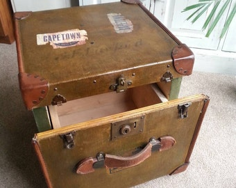 Vintage trunk coffee table with drawer. Vintage 1910's Red Star liner half trunk.