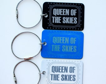Queen of the Skies Aluminum luggage tag with Boeing aircraft window design.