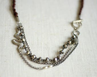 Multi Strand Necklace with Crystals and Snake Charm