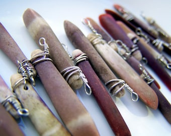 20 for 7.  Sea Urchin charms or pendant sticks. 20 for seven dollars. wire wrapped coral shells