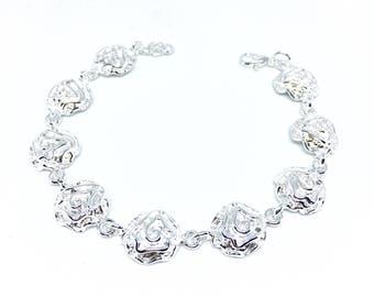 Floral silver metal bracelet.