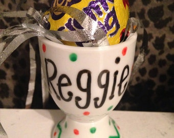 Hand decorated personalised egg cup with easter chocolate creme egg