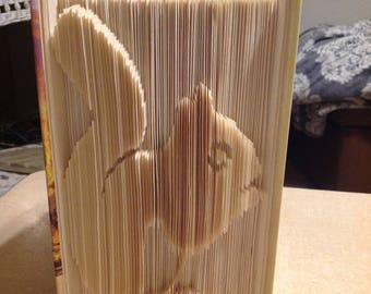 Squirrel cut and fold outie pattern