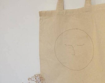 moon face embroidered tote bag