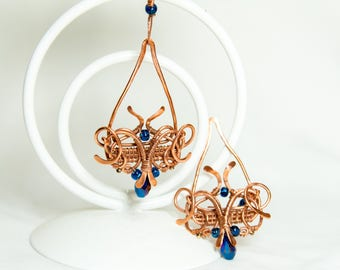 Copper earrings with blue glass stone