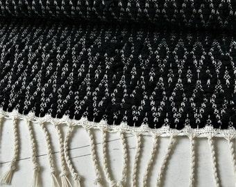 Handwoven rug with recycled denim & black hemp yarn