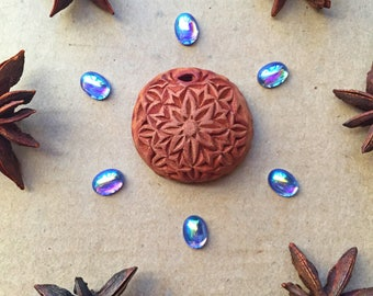 Beautiful round carved avocado stone pendand necklace with geometrical design. Hand carved piece of wearable art.