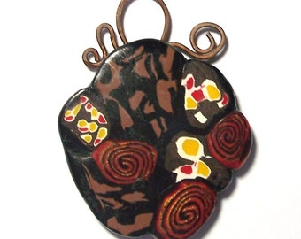 Brown Red Yellow and Black Freeform Floral Polymer Clay Pendant with Handmade Copper Scrolled Bail by Carol Wilson of PollyClayDesigns