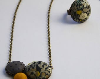 Necklace in brass and liberty English grey and mustard