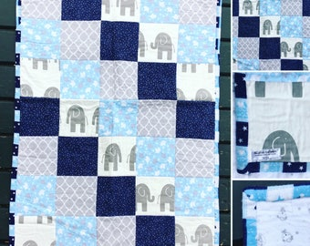 Patchwork Crib Quilt in greys and blues with elephants detail. White flannel backing.