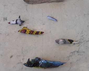 Driftwood mobile, depicting colorful fish.