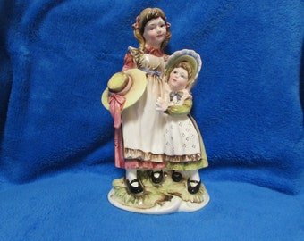 Vintage two girls with hats porcelain figurine
