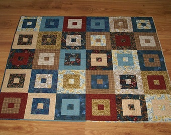 Boxed Squares lap quilt in shades of cream, tan, brown, teal and rust