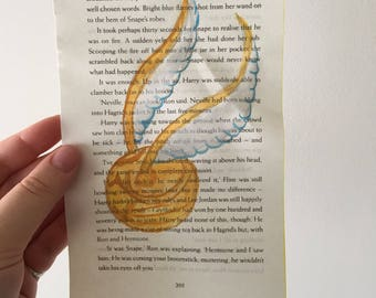 Golden snitch hand painted watercolour Harry Potter inspired book pages.