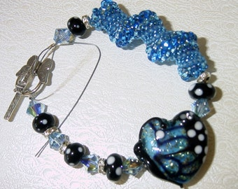 Butterfly BLING Lampwork and Seed Tube Bead Bracelet. SRAJD