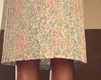 Pleated floral below the knee skirt