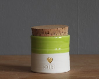 pet urn. straight shaped urn with custom name and stamp. modern urn for ashes. funerary urn. porcelain, lime with gold heart shown