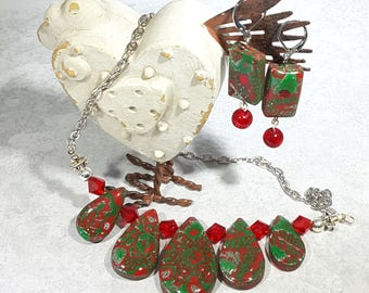 Christmas Style Necklace and earring set. Handcrafted red, green and silver Polymer Clay. Graduated teardrops with Snowflake design.