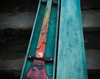 Electric 3-string diddley bow. Fretless guitar by DaShtick guitars. Left-handed guitar.