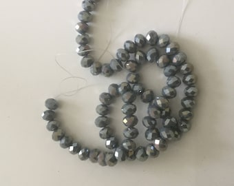 A faceted 8 mm grey AB 8 mm Crystal bead