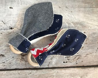 Assorted fabrics and 'anchor' teething toy (may different from photo)