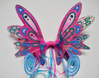 Double panelled pink, teal and turquoise iridescent fairy wings with curly antennae.