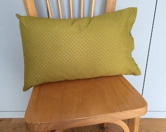 Olive green pillow with silver stars