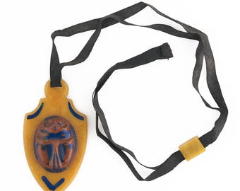 Vintage Art Deco Egyptian Revival Galalith scarab pendant silk ribbon. pdbk106