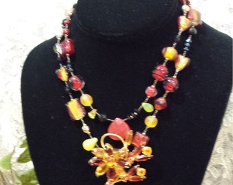 Two strand necklace with vintage drop