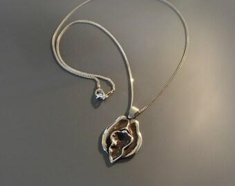 Anatomical Vulva / Yoni / Vagina Necklace in Sterling Silver by medical illustrator Beth Croce