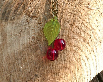 Yummy cherry necklace with green leaf style pin up and rockabilly - cherry necklace bronze or silver - colored metal