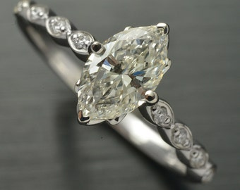 Diamond Engagement ring solitaire Marquise Shape in 18kt white gold 1.01 carat center stone.