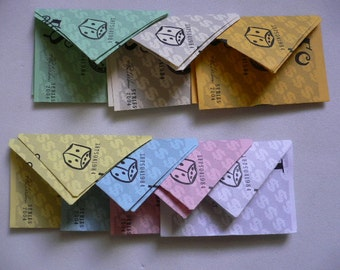 14 Tiny Handmade Monopoly Envelopes 2 each of 7 colors and denominations,  1's, 5's, 10's, 20's, 50's, 100's and 500's./
