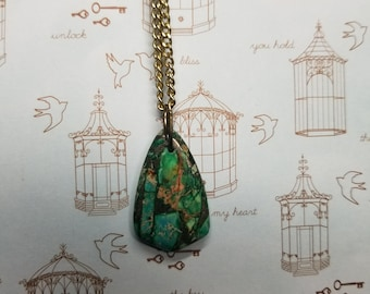 Green and gold triangular stone necklace.