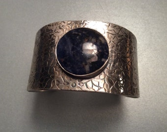 sterling silver cuff set with blue sodalite stone